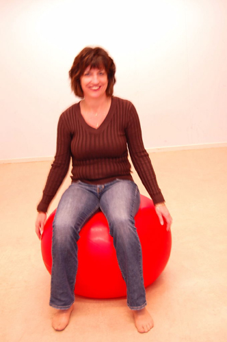 sitting on a ball to music