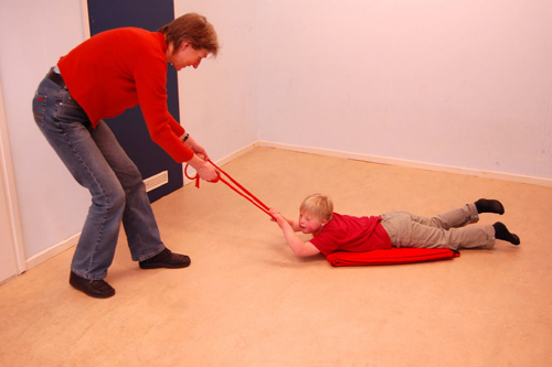 pulling your kid around on a blanket