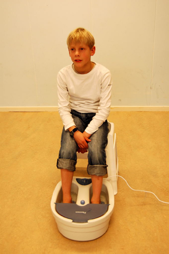 kid with feet in foot massager